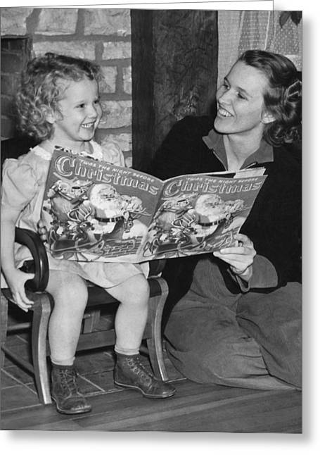 Child Reading A Christmas Book Greeting Card by E. Earl Curtis
