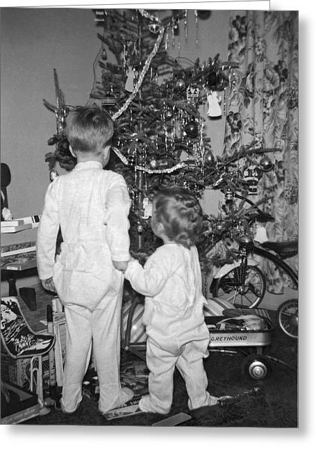 Children Check Christmas Tree Greeting Card by Underwood Archives
