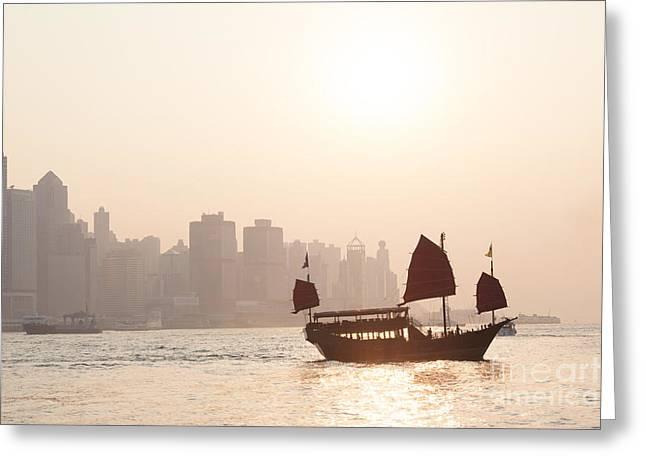 Chinese Junk Boat Sailing In Hong Kong Harbor Greeting Card by Matteo Colombo