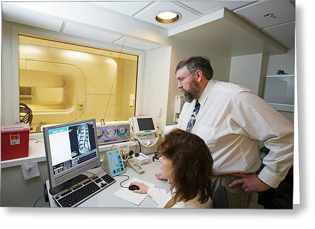 Chiropractor Examining Spinal Mri Scan Greeting Card by Jim West