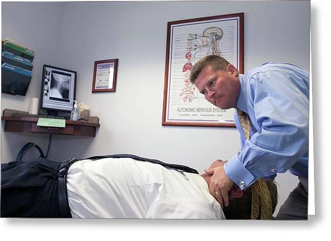 Chiropractor Manipulating Patient Greeting Card