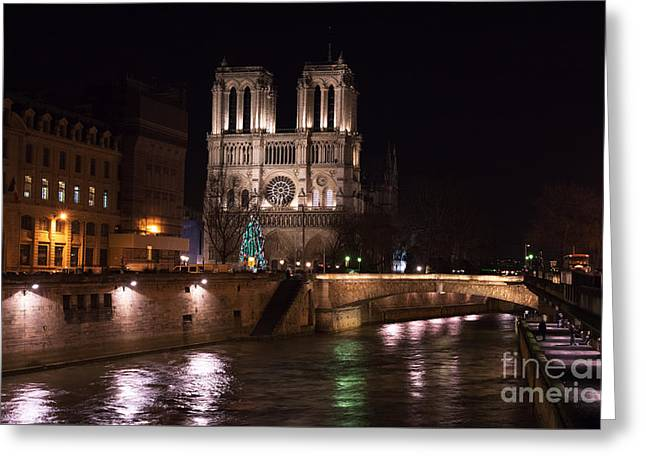 Christmas At Notre Dame Greeting Card by John Rizzuto