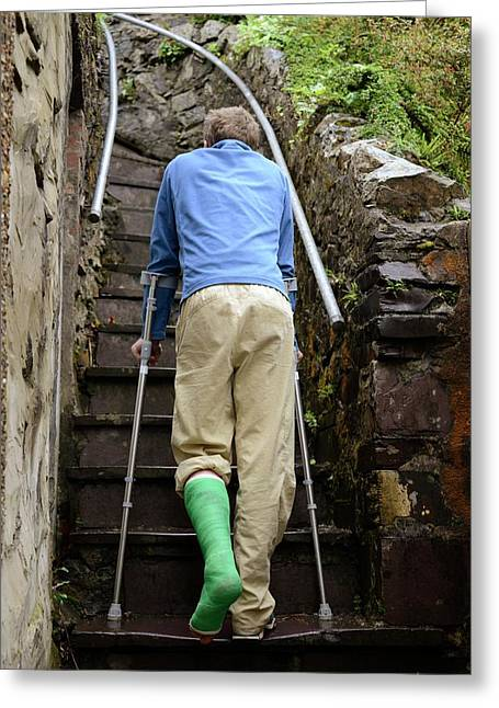 Climbing Steps On Crutches Greeting Card by Cordelia Molloy