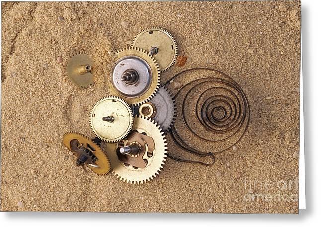 Clockwork Mechanism On The Sand Greeting Card by Michal Boubin