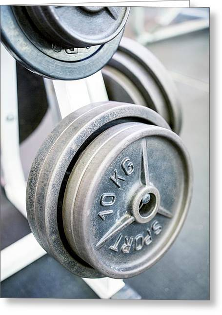 Close-up Of Weight Plates Greeting Card by Science Photo Library
