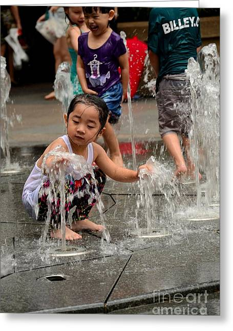 Clothed Children Play At Water Fountain Greeting Card
