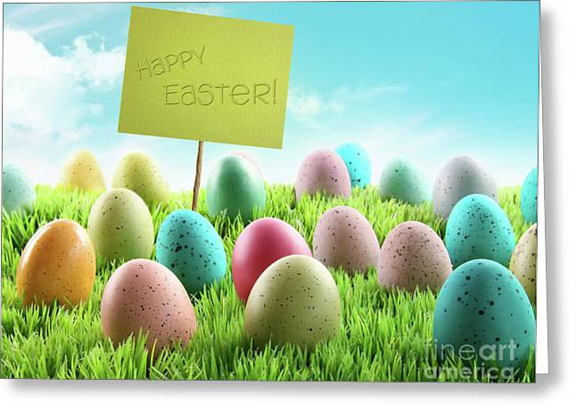 Colorful Easter Eggs With Sign In A Field Greeting Card by Sandra Cunningham