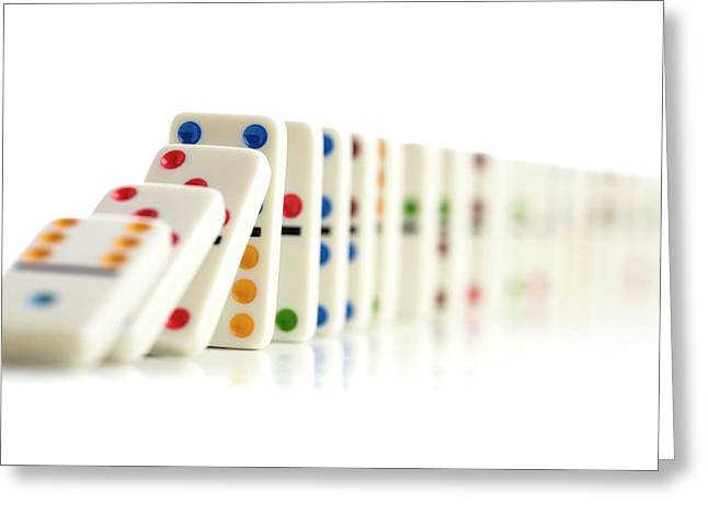 Colourful Dominoes Falling Down Greeting Card by Science Photo Library