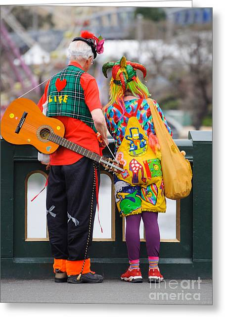 Colourfully Dressed Buskers Pause On The Way Home Greeting Card