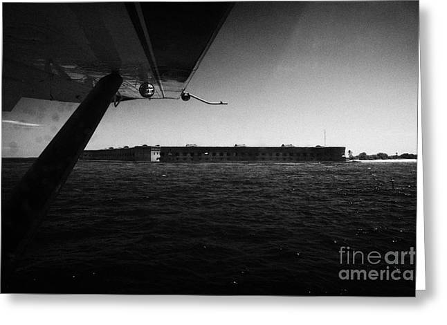 Coming In To Land On The Water In A Seaplane Next To Fort Jefferson Garden Key Dry Tortugas Florida  Greeting Card by Joe Fox