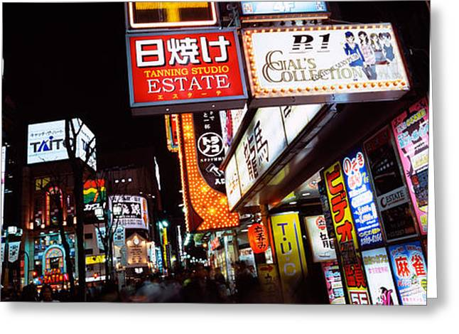 Commercial Signboards Lit Up At Night Greeting Card