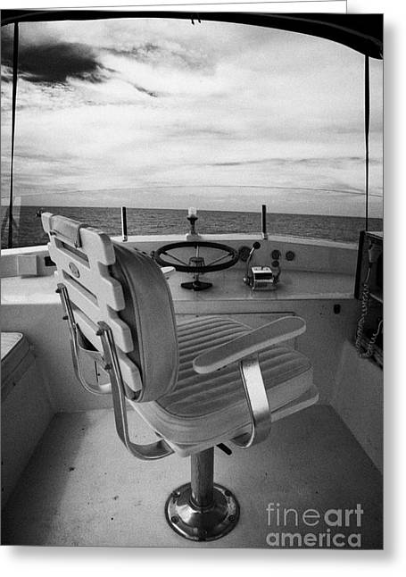Controls On The Flybridge Deck Of A Charter Fishing Boat In The Gulf Of Mexico Greeting Card by Joe Fox