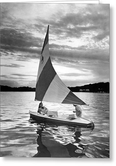 Couple Enjoys A Sunset Sail Greeting Card
