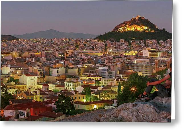 Couple Looking Out Over Athens Greeting Card by Babak Tafreshi