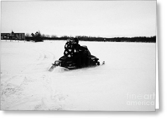 couple on a snowmobile going cross country Kamsack Saskatchewan Canada Greeting Card