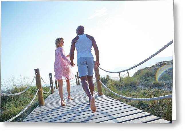 Couple On Boardwalk On Holiday Greeting Card by Ruth Jenkinson