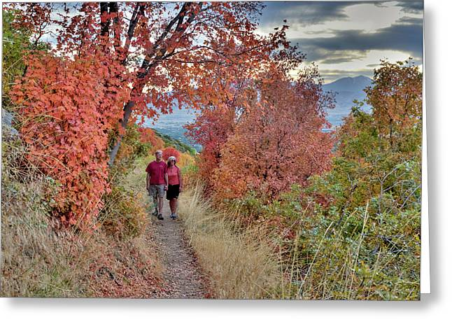 Couple On Trail Among Fall Foliage Greeting Card by Howie Garber