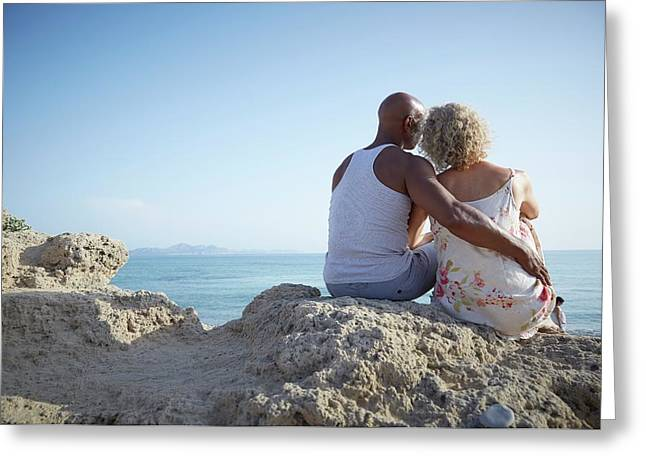 Couple Sitting On A Rock Greeting Card by Ruth Jenkinson