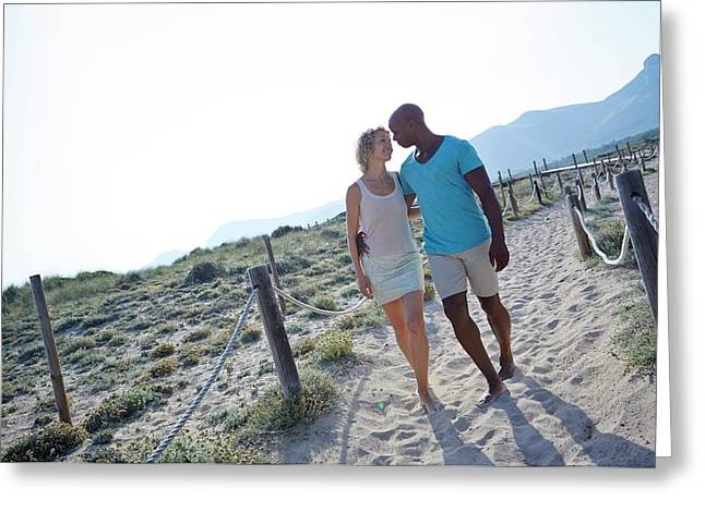 Couple Walking On Sand On Holiday Greeting Card by Ruth Jenkinson