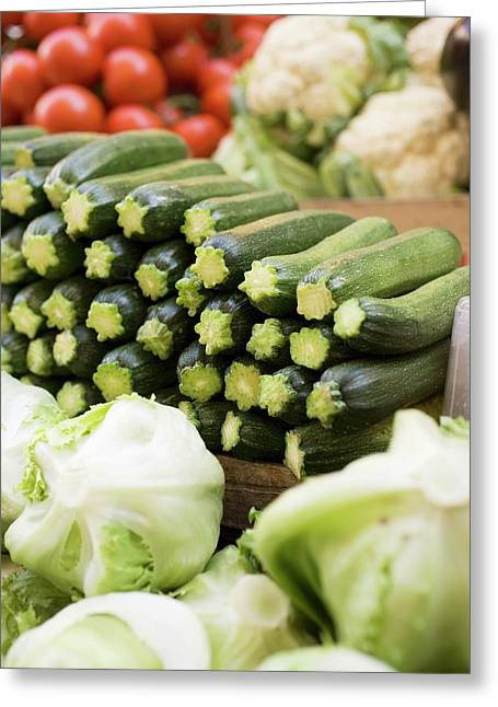 Courgettes, Lettuces, Cauliflowers And Tomatoes At A Market Greeting Card