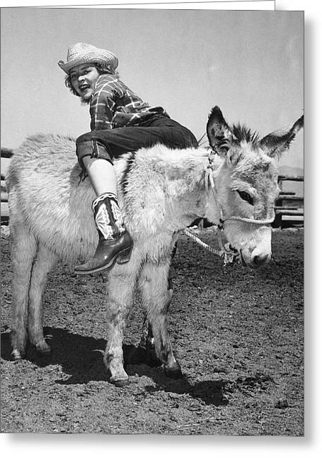 Cowgirl Backwards On A Donkey Greeting Card by Underwood Archives