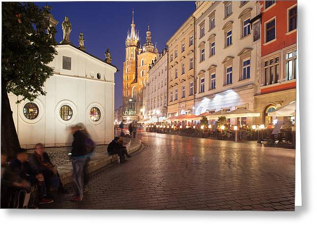 Cracow By Night In Poland Greeting Card by Artur Bogacki