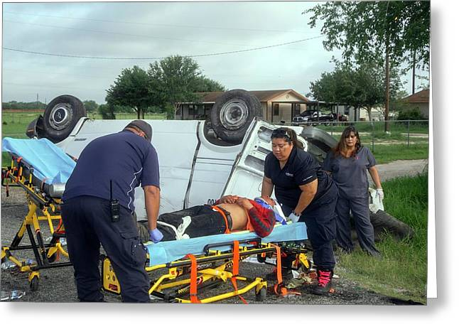 Crash Victim Being Treated Greeting Card by Jim West