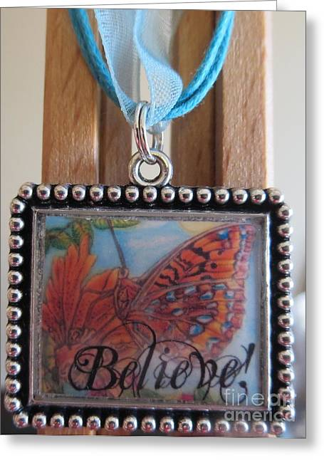 Believe...a Colorful Butterfly Lights Upon A Tiger Lily In A Necklace Greeting Card by Kimberlee Baxter