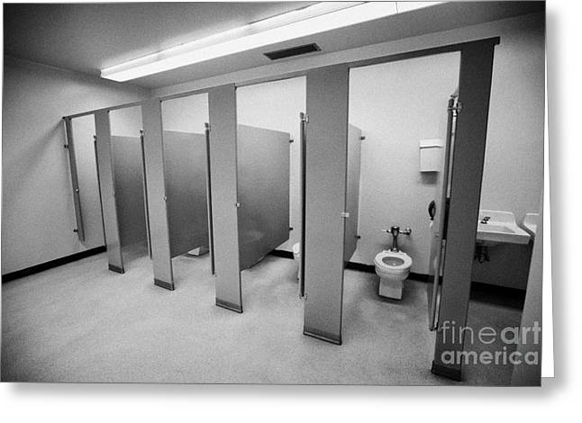 cubicle toilet stalls in womens bathroom in a High school canada north america Greeting Card by Joe Fox