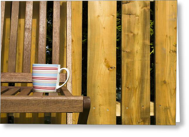 Cup On Garden Chair Greeting Card