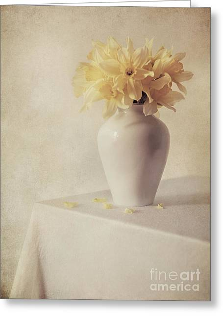 Daffodils In White Flower Pot On The Table Greeting Card by Jaroslaw Blaminsky