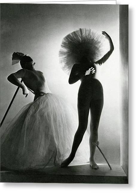 Dancers Posing In Costumes From Salvador Dali's Greeting Card by Horst P. Horst