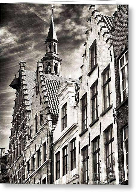 Dark Sky In Bruges Greeting Card by John Rizzuto