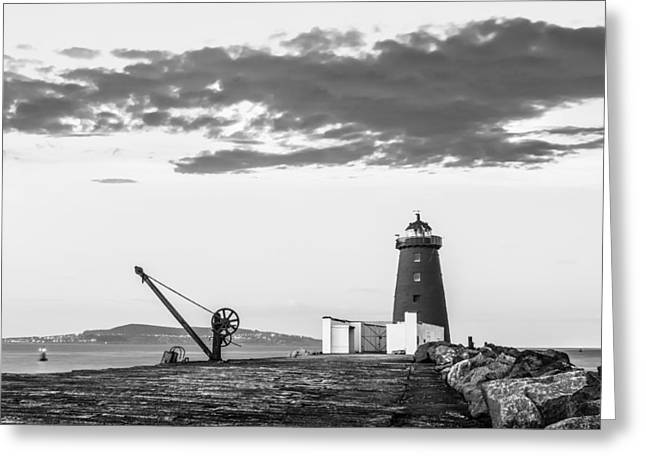 Davit And Lighthouse On A Breakwater Greeting Card by Semmick Photo