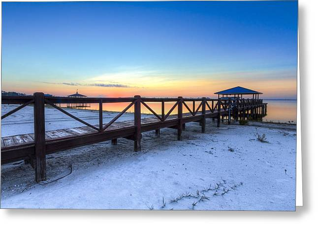 Dawn At The Dock Greeting Card by Debra and Dave Vanderlaan