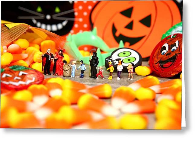 Death Takes His Kids Trick Or Treating Greeting Card by Lon Casler Bixby
