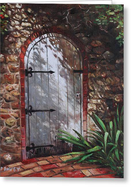 Decorative Door In Archway Set In Stone Wall Surrounded By Plants Greeting Card by Martin Davey