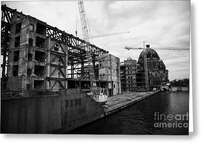 demolition of the Palast der Republik on the bank of the river Spree with the Berliner Dom in the background Berlin Germany Greeting Card