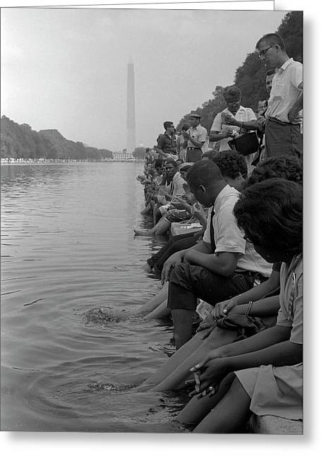 Demonstrators Sit Along The Reflecting Greeting Card by Stocktrek Images