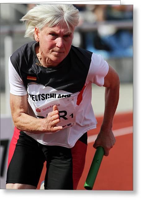 Determined Female Senior Athlete Running Greeting Card