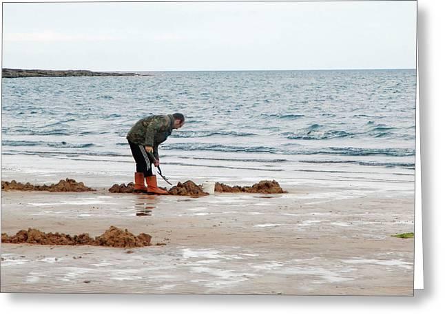 Digging On A Beach Greeting Card by Public Health England