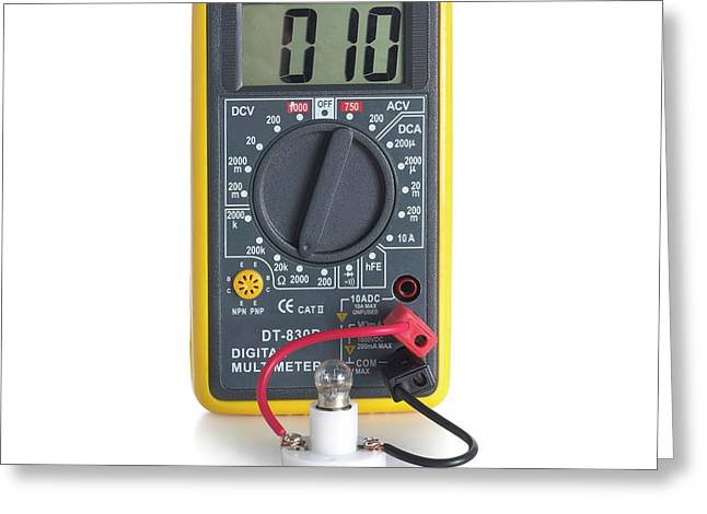 Digital Multimeter With Lightbulb Greeting Card by Science Photo Library