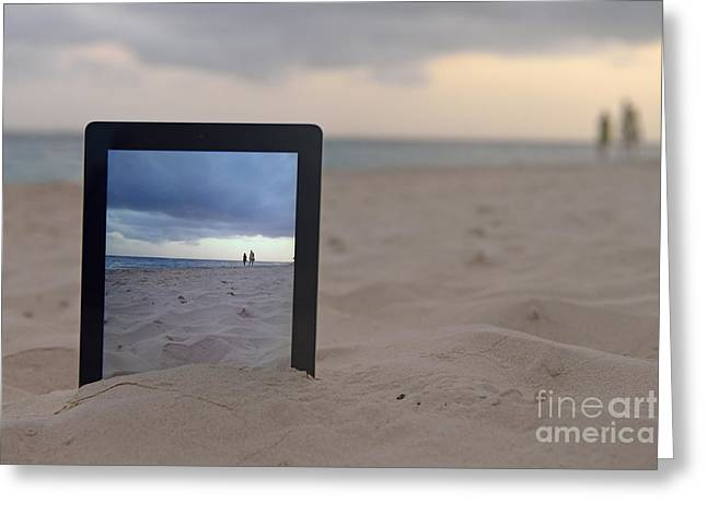 Digital Tablet In Sand On Beach Greeting Card by Sami Sarkis