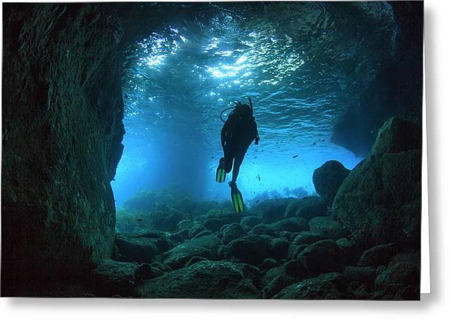 Diver Swimming Through A Sea Cave Greeting Card