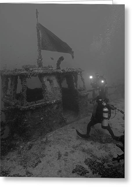 Divers Explore The Massive Uss Spiegel Greeting Card by Brent Barnes