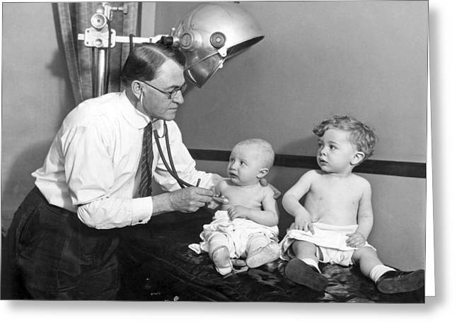 Doctor Examines Baby Greeting Card by Underwood Archives
