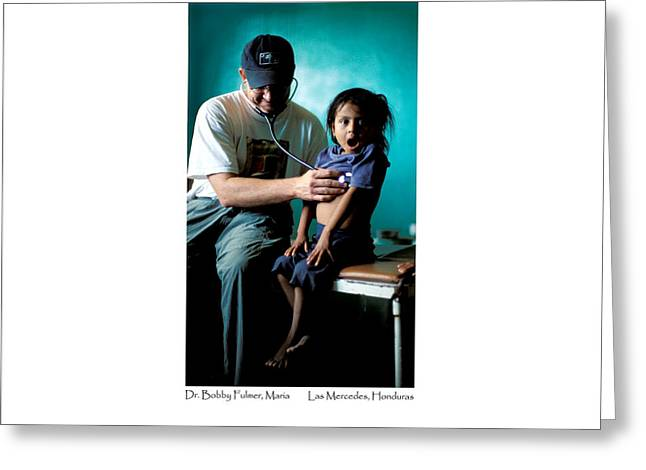 Greeting Card featuring the photograph Doctor Examines Honduran Girl by Tina Manley