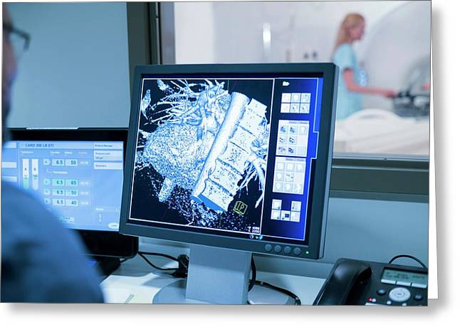 Doctor Looking At Mri Scans On Monitor Greeting Card by Science Photo Library