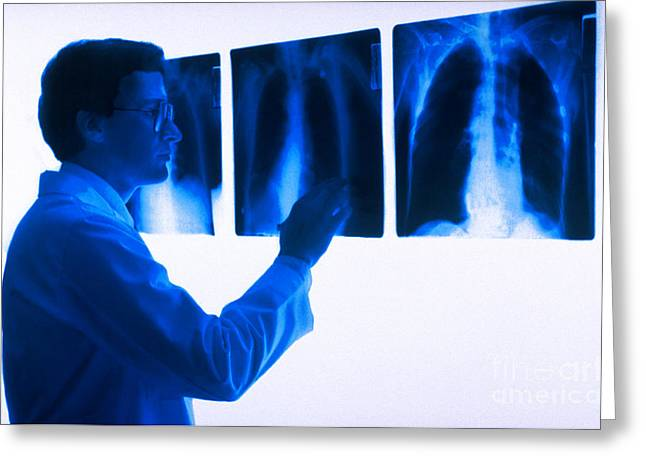 Doctor Views X-rays Greeting Card by Dennis Potokar