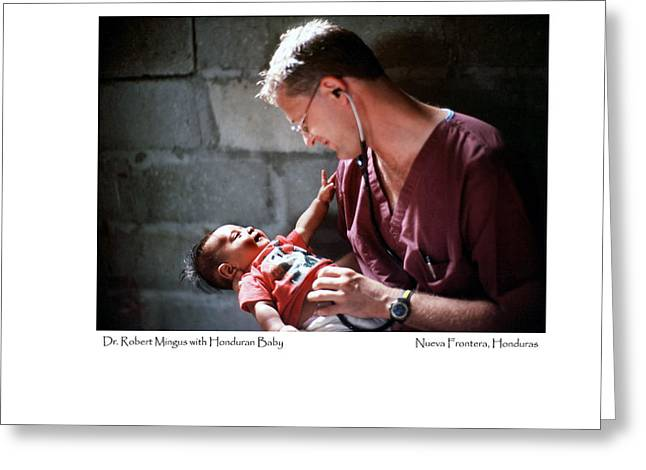 Greeting Card featuring the photograph Doctor With Honduran Baby by Tina Manley